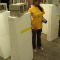 Waiting for glue to dry so we can tape the bigger mold chunks together... the cinder blocks help apply pressure to bond the mold