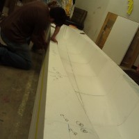 The positioned canoe mold is taped together