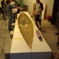 Now we prep the concrete canoe for curing, a 4-week process in total.
