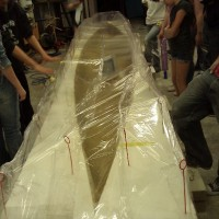 The canoe will cure in this sealed, humidified shell for the next week.
