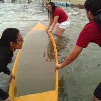Swamp test: completely submerge the canoe to prove it can resurface. Our canoe floats too well to swamp...