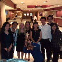 After the award ceremony in the evening, the environmental team poses with their first-place trophy