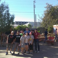 USC group in front of the garden, as the raised beds are prepared for planting.