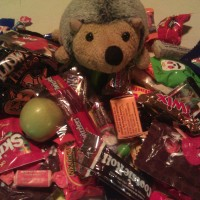 Phil went Trick-or-Treating and got a lot of candy, and a random mini apple