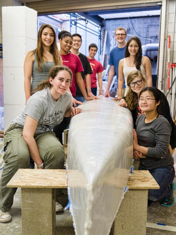 Our 2014 practice canoe, DiSCovery I, fresh out of the mold, with the construction team.