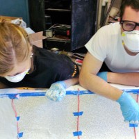 Kelly and Noah placing the first layer