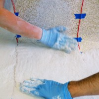 Smoothing the first layer of concrete