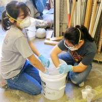 Elise and Rosa, still mixing endless buckets of concrete