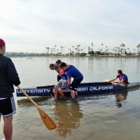Loading the canoe for the Men's Endurance race.