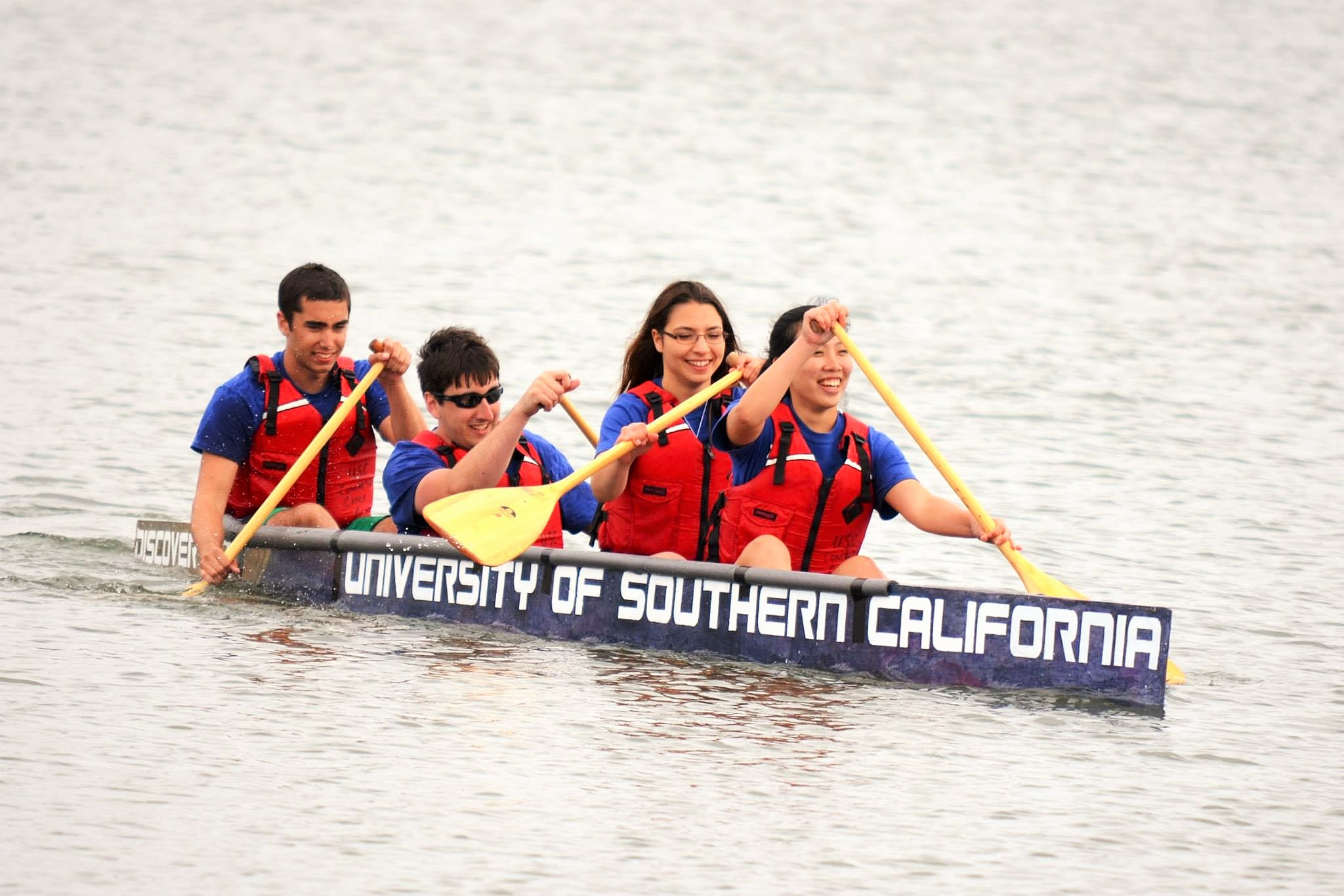 Concrete canoe team members race their canoe at PSWC 2014.