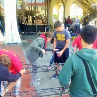 Everyone helps disassemble the bridge after the competition.