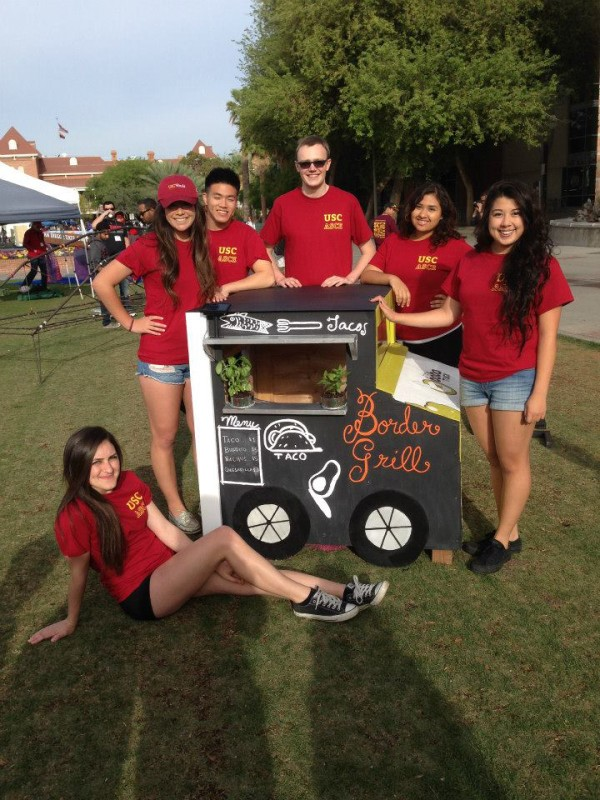 "The 2015 USC Dog House Team poses with their food-truck-themed dog house: ""A Trip Around LA""."