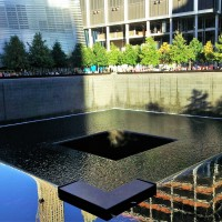 World Trade Center - South pool, with the 9/11 memorial and Three World Trade Center in the background.