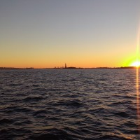 Sunset and the Statue of Liberty, from Battery Park.