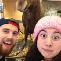 Sponsorship Chairs Alex and Marissa in front of - is that a moose?