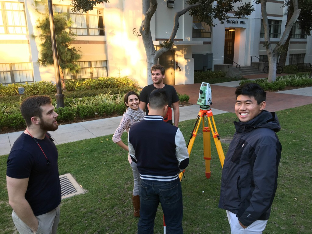 Surveying team members practice in E-Quad.