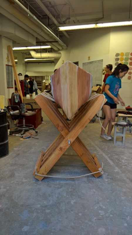 The concrete canoe team tests out their new, reusable folding wood canoe stands.